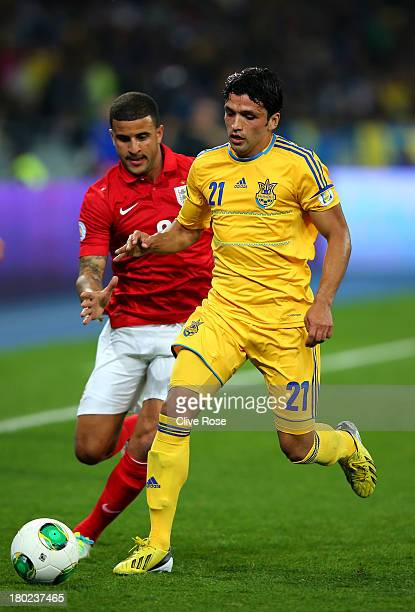 Edmar of Ukraine is pursued by Kyle Walker of England during the FIFA 2014 World Cup Qualifying Group H match between Ukraine and England at the...