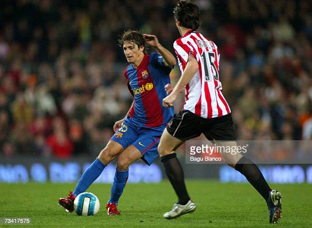 Edmilson of Barcelona and Iraola of Athletic go to kick during the match between FC Barcelona and Athletic Club de Bilbao of La Liga at the Camp Nou...
