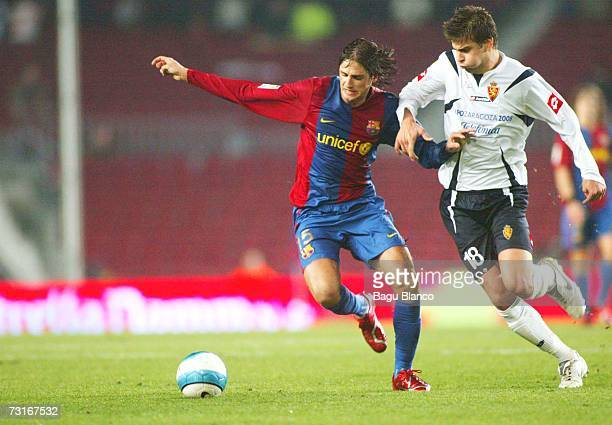 Edmilson of Barcelona and Pique of Zaragoza in action during the match between FC Barcelona and Real Zaragoza of Copa del Rey 1/4 finals on January...