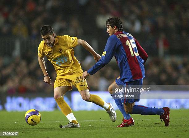 Edmilson of Barcelona and Portillo of Gimnastic in action during the La Liga match between FC Barcelona and Gimnastic de Tarragona at the Camp Nou...