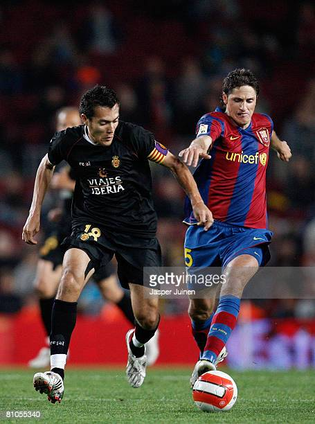 Edmilson of Barcelona duels for the ball with Juan Arango of Mallorca during the La Liga match between Barcelona and Mallorca at the Camp Nou Stadium...