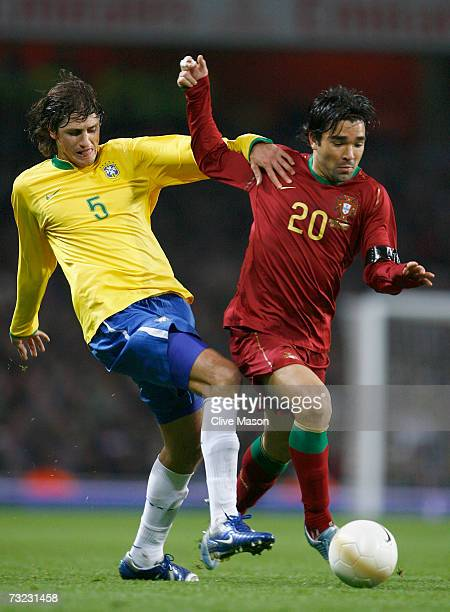 Edmilson of Brazil battles with Deco of Portugal during the International friendly match between Brazil and Portugal at the Emirates Stadium on...