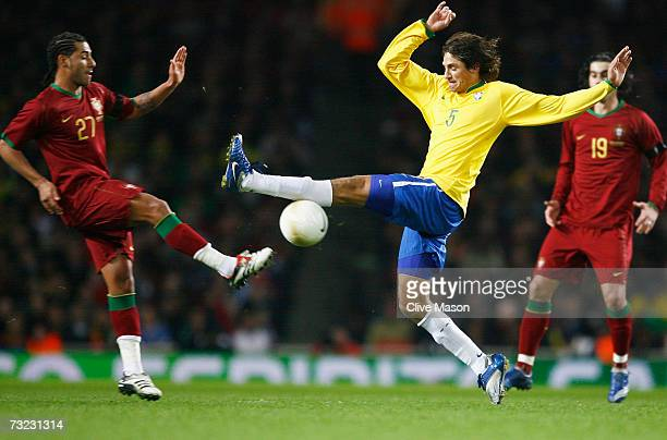 Edmilson of Brazil challenges Ricardo Quaresma of Portugal during the International friendly match between Brazil and Portugal at the Emirates...