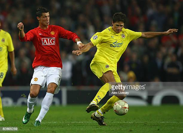 Edmilson of Villareal holds off the challenge of Cristiano Ronaldo of Manchester United during the UEFA Champions League Group E match between...