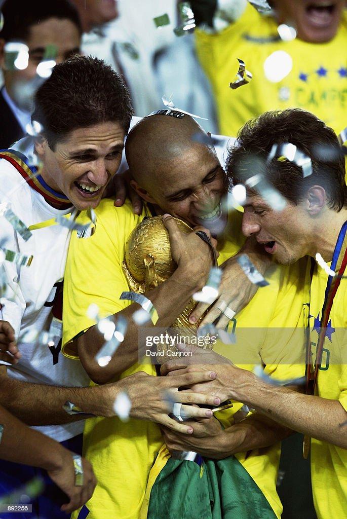 Edmilson, Roberto Carlos and Juninho Paulista of Brazil celebrate with the trophy after the Germany v Brazil, World Cup Final match played at the International Stadium Yokohama in Yokohama, Japan on June 30, 2002. Brazil won 2-0.