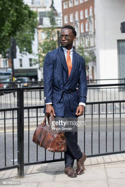 Edmond Kamara wearing a Saran Kohli jacket Turnbull and Asser Tie Paul Smith shoes Garrett Leight sunglasses and a vintage bag during London Fashion...