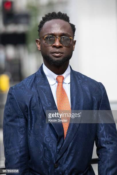 Edmond Kamara wearing a Saran Kohli jacket Turnbull and Asser Tie Garrett Leight sunglasses during London Fashion Week Men's on June 10 2018 in...