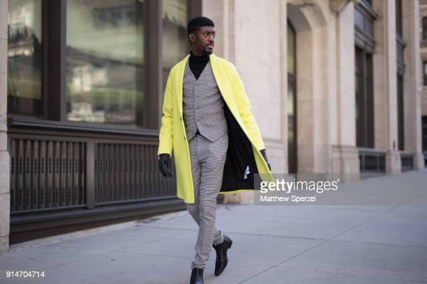 Edmond Parrish is seen on the street attending Suitsupply during New York Fashion Week Men's wearing ASOS on February 5 2018 in New York City