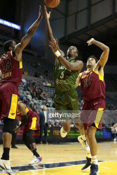 Edmond Summer of the Fort Wayne Mad Ants Grant Jerrett and Gerald Beverly of the Canton Charge on March 16 2018 at Memorial Coliseum in Fort Wayne...