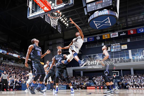 Edmond Sumner of the Xavier Musketeers drives to the basket past Angel Delgado and Isaiah Whitehead of the Seton Hall Pirates in the second half of...
