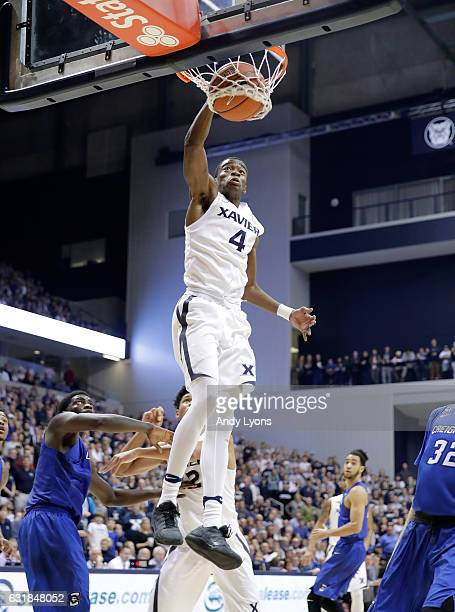 Edmond Sumner of the Xavier Musketeers dunks the ball against the Creighton Blue Jays during the game at Cintas Center on January 16 2017 in...