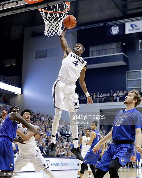 Edmond Sumner of the Xavier Musketeers goes up to dunk the ball against the Creighton Blue Jays during the game at Cintas Center on January 16 2017...