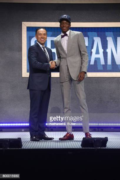 Edmond Sumner shakes hands with Deputy Commissioner Mark Tatum after being selected number fifty two overall by the New Orleans Pelicans during the...