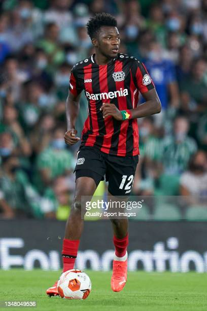 Edmond Tapsoba of Bayer Leverkusen runs with the ball during the UEFA Europa League group G match between Real Betis and Bayer Leverkusen at Estadio...