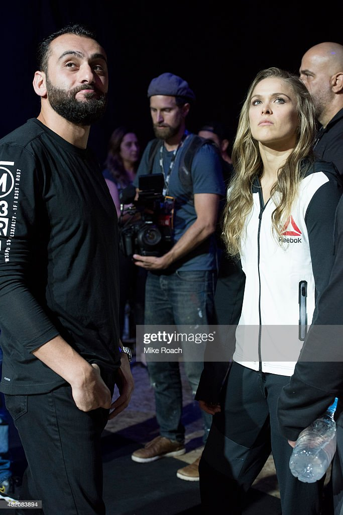 Edmond Tarverdyan and UFC women's bantamweight champion Ronda Rousey of the United States wait backstage during the UFC 190 weigh-in event at the HSBC Arena on July 31, 2015 in Rio de Janeiro, Brazil.