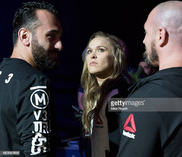 Edmond Tarverdyan, UFC women's bantamweight champion Ronda Rousey of the United States and Mike Dolce wait backstage during the UFC 190 weigh-in...