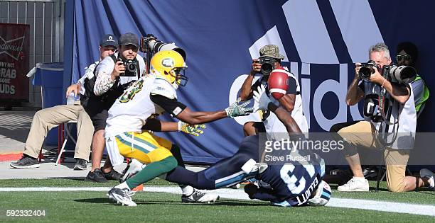 Edmonton Eskimos defensive back Marcell Young interferes withToronto Argonauts wide receiver Kevin Elliott in the end zone. Toronto Argonauts play...
