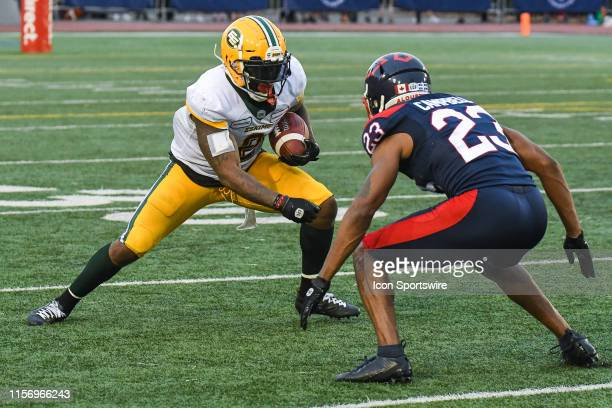 Edmonton Eskimos Running back CJ Gable runs with the ball facing coverage by Montreal Alouettes Defensive back Tommie Campbell during the Edmonton...
