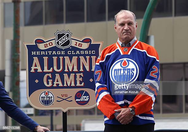 Edmonton Oilers alumni Dave Semenko poses with the 2016 Heritage Classic Alumni Game logo during the press conference held at the Outdoor Plaza at...