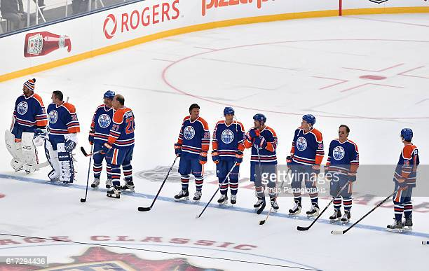 Edmonton Oilers alumni line up for player introductions during the 2016 Tim Hortons NHL Heritage Classic alumni game at Investors Group Field on...