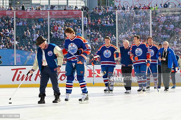 Edmonton Oilers alumni players escort Glen Sather and John Muckler onto the ice for the team picture before the 2016 Tim Hortons NHL Heritage Classic...