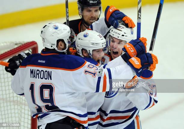Edmonton Oilers captain Connor McDavid celebrates with his teammates after an Oilers goal scored ibn the first period of game 7 of the second round...