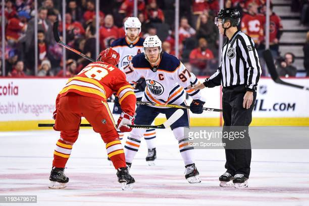 Edmonton Oilers Center Connor McDavid and Calgary Flames Center Elias Lindholm line up for a face-off during the first period of an NHL game where...