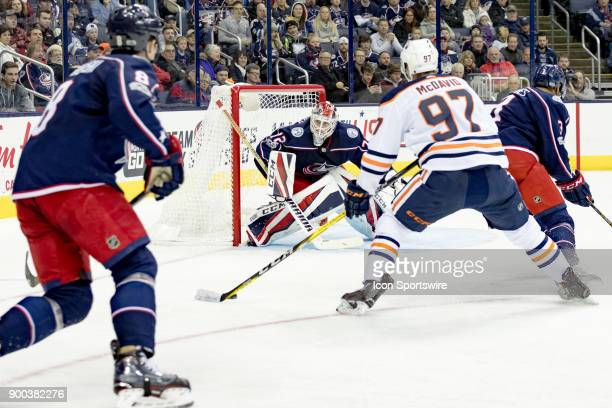 Edmonton Oilers center Connor McDavid attempts a shot on goal as Columbus Blue Jackets goalie Sergei Bobrovsky defends during a game between the...