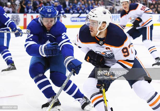 Edmonton Oilers center Connor McDavid battles with Toronto Maple Leafs defenseman Nikita Zaitsev during the second period in a game between the...