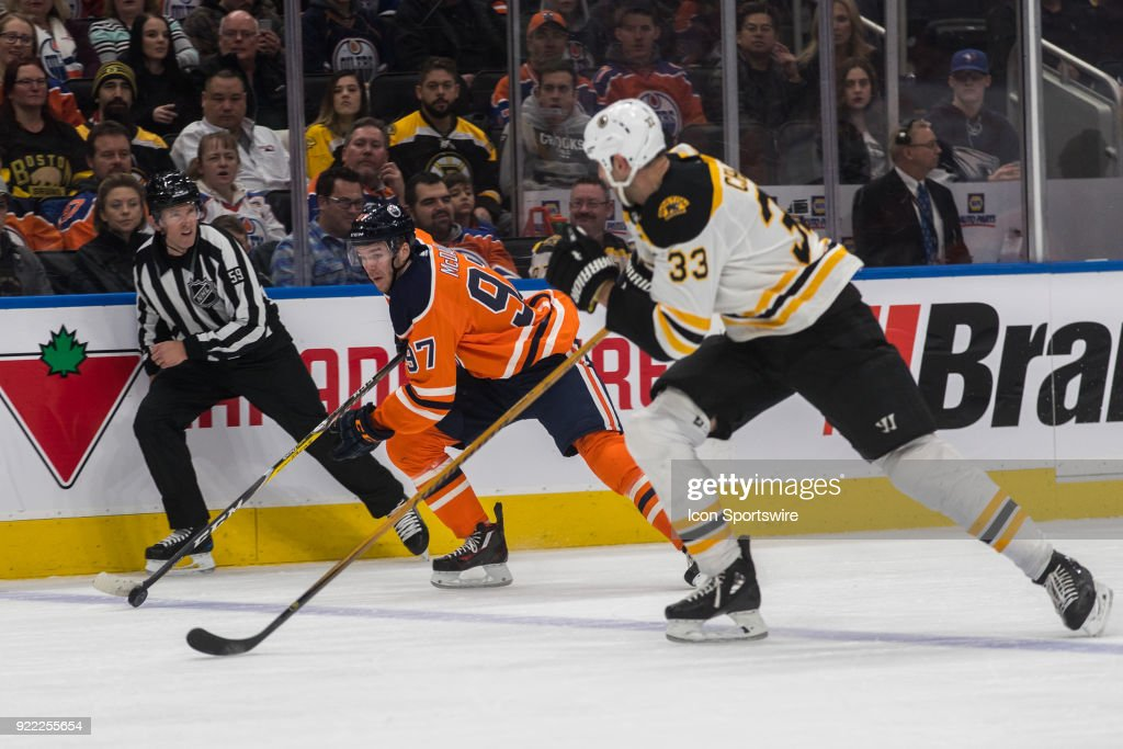 Edmonton Oilers Center Connor McDavid (97) is chased by Boston Bruins Defenceman Zdeno Chara (33) during the Edmonton Oilers versus the Calgary Flames at Rogers Place on February 20, 2018 in Edmonton, Alberta.