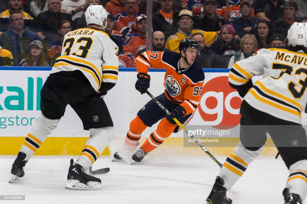 Edmonton Oilers Center Connor McDavid (97) is watched by Boston Bruins Defenceman Zdeno Chara (33) during the Edmonton Oilers versus the Calgary Flames at Rogers Place on February 20, 2018 in Edmonton, Alberta.