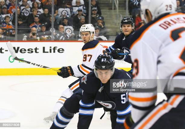 Edmonton Oilers Center Connor McDavid looks for a centering pass during a NHL game between the Winnipeg Jets and Edmonton Oilers on December 27 2017...
