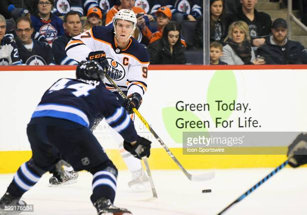 Edmonton Oilers Center Connor McDavid makes a centering pass during a NHL game between the Winnipeg Jets and Edmonton Oilers on December 27 2017 at...