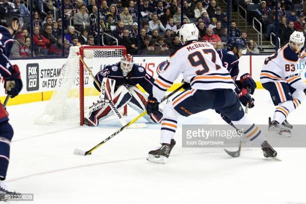 Edmonton Oilers center Connor McDavid prepares to take a shot on goal while Columbus Blue Jackets goalie Sergei Bobrovsky defends during the second...