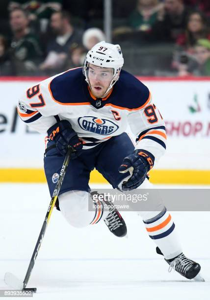 Edmonton Oilers Center Connor McDavid skates the puck up ice during a NHL game between the Minnesota Wild and Edmonton Oilers on December 16 2017 at...
