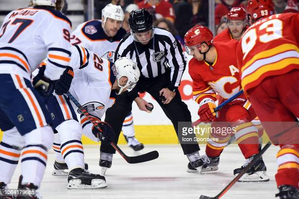 Edmonton Oilers Center Leon Draisaitl and Calgary Flames Center Mikael Backlund square off during the second period of an NHL game where the Calgary...