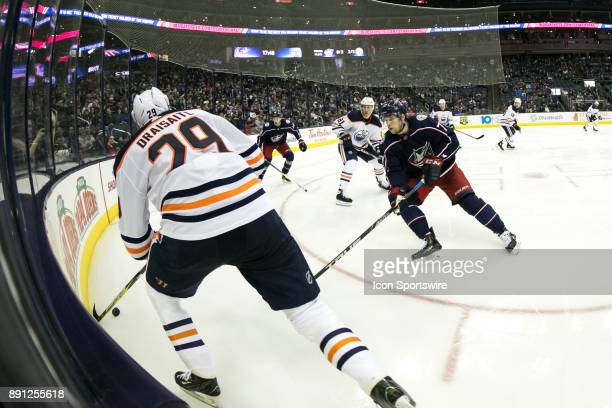 Edmonton Oilers center Leon Draisaitl and Columbus Blue Jackets right wing Josh Anderson battle for the puck during the third period in a game...