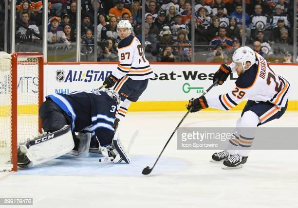Edmonton Oilers Center Leon Draisaitl beats Winnipeg Jets Goalie Connor Hellebuyck for a 1st period goal after taking a drop pass from Edmonton...