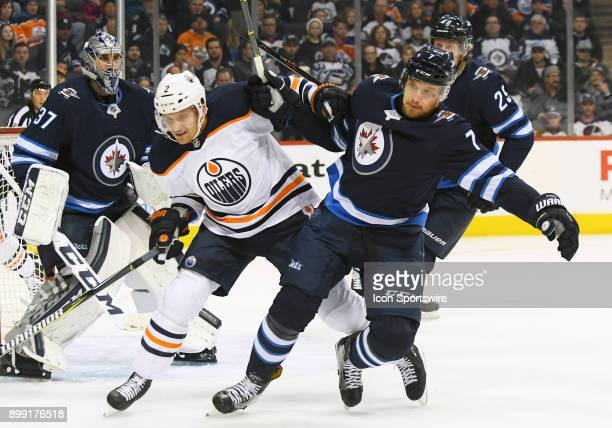 Edmonton Oilers Defenceman Andrej Sekera and Winnipeg Jets Defenceman Ben Chiarot fight for space during a NHL game between the Winnipeg Jets and...