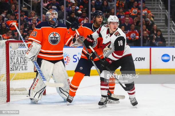 Edmonton Oilers Defenceman Darnell Nurse and Arizona Coyotes Center Christian Dvorak battle infant of the net during the Edmonton Oilers versus the...