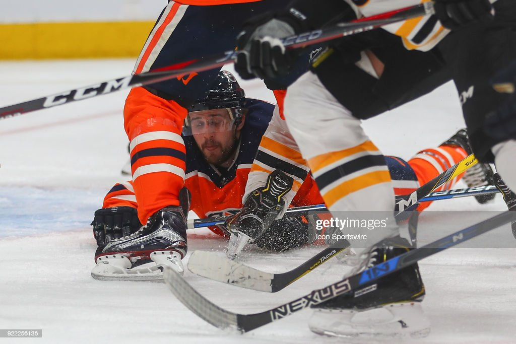 Edmonton Oilers Defenceman Kris Russell (4) dives for a puck during the Edmonton Oilers versus the Calgary Flames at Rogers Place on February 20, 2018 in Edmonton, Alberta.