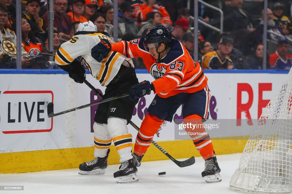 Edmonton Oilers Defenceman Matt Benning (83) battles a Boston player behind the net during the Edmonton Oilers versus the Calgary Flames at Rogers Place on February 20, 2018 in Edmonton, Alberta.
