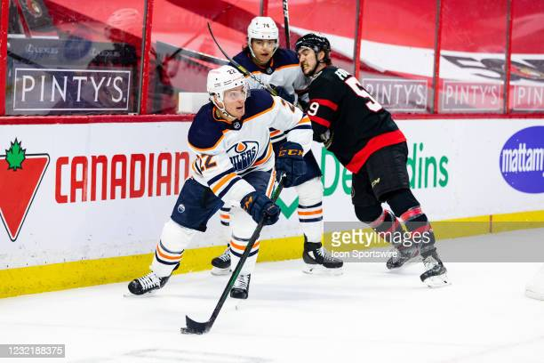 Edmonton Oilers Defenceman Tyson Barrie skates the puck around the net during second period National Hockey League action between the Edmonton Oilers...
