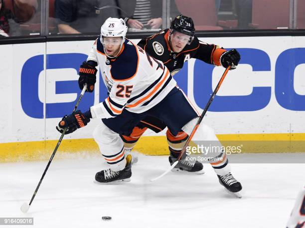 Edmonton Oilers defenseman Darnell Nurse keeps in front of Anaheim Ducks rightwing Corey Perry during the first period of a game played on February 9...