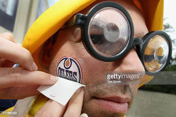 Edmonton Oilers fan Derek Pickford of Edmonton gets a temporary tattoo outside of Rexall Place before game four of the 2006 NHL Stanley Cup Finals...