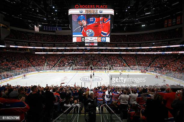 Edmonton Oilers fans celebrate a goal by Patrick Maroon during the home opener against the Calgary Flames on October 12 2016 at Rogers Place in...