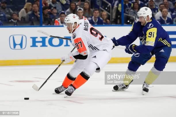 Edmonton Oilers forward Connor McDavid skates the puck away from Tampa Bay Lightning forward Steven Stamkos during the 2018 NHL AllStar Game between...