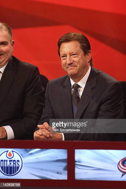 Edmonton Oilers General Manager Steve Tambellini reacts after the announcement that the first pick would go to his team during the NHL Draft Lottery...