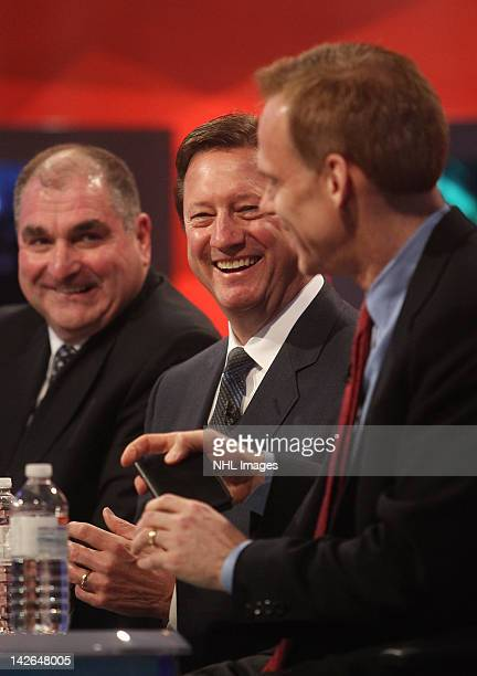 Edmonton Oilers General Manager Steve Tambellini talks to Columbus Blue Jackets General Manager Scott Howson and Montreal Canadiens Assistant General...