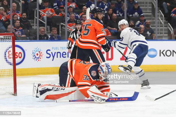 Edmonton Oilers Goalie Anthony Stolarz coves the puck after making a save in the second period during the Edmonton Oilers game versus the Toronto...